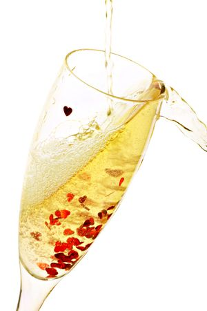 glass of bubbly champagne with lovehearts Stock Photo - 5588395