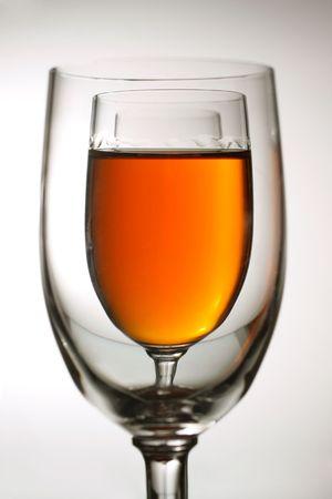 amber coloured: glasses of amber coloured beverage