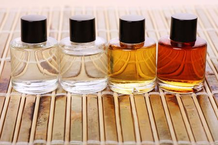 A row of essential oils, ready for beauty treatment Stock Photo
