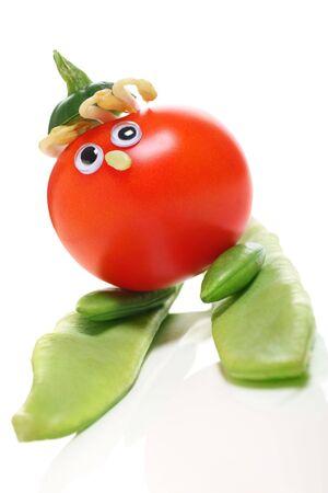 quizzical: variedad de verduras para hacer un divertido personaje, el concepto de comer sano y vivir.