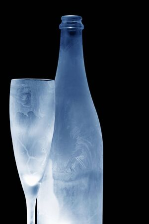 frosted: frosted champagne bottle and glass toned blue Stock Photo