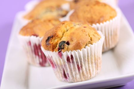 delicious homemade summer fruit muffins, contains blueberries, raspberries and blackberries  photo