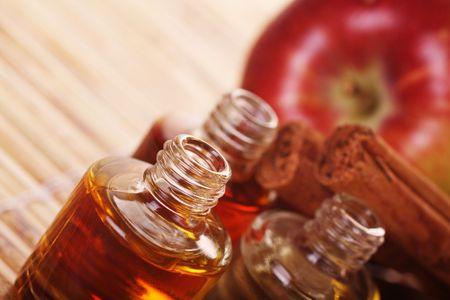 Apple cinnamon aromatherapy. Sahllow depth of field. Focus to front bottle Stock Photo