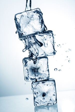 ice blocks: ice cubes and flowing water, with blue toning applied for effect. Stock Photo