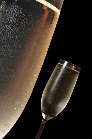 two glasses of chilled champagne showing condensation and bubbles  photo