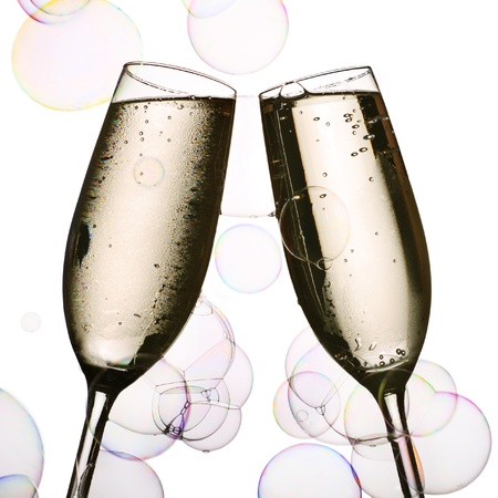 two glasses of chilled champagne and party bubbles