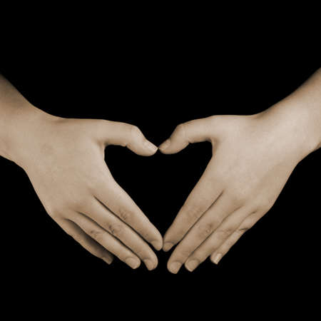 ronantic: love heart hands, sepia toned on a black background.