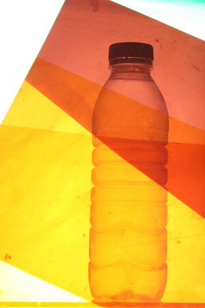 occur: bottled water taken behind coloured gels to create artistic image  imperfections of gels causing grunge effect  focus is on the image and not the gels so blurring does occur in parts of the image