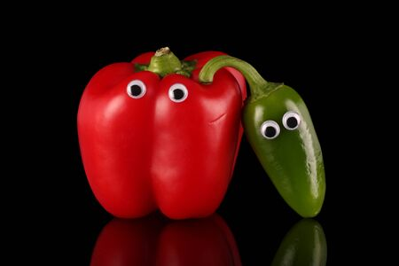 red pepper: Red bell pepper with friendly chilli , humorous pose.