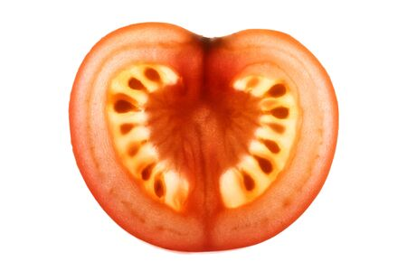 Tomato slice backlit showing intricate detail . Stock Photo