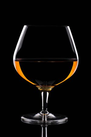 amber coloured: Snifter glass with beautiful amber coloured alcohol.