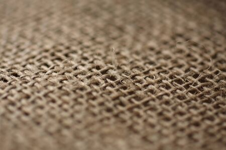 weave: piece of hessian cloth , shallow depth of field to create effect of blur. Stock Photo