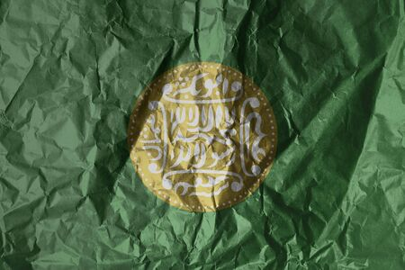 Rohingya flag painted on crumpled paper background