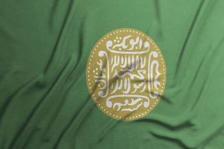 Close-up of the Rohingya Flag waving used for background Фото со стока