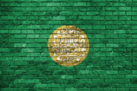 Rohingya flag painted on a brick wall, Background texture 스톡 콘텐츠