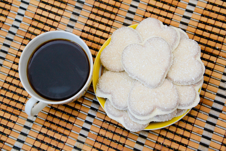 Heart shaped cookies and a cup of coffee photo