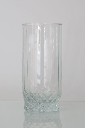 Glass beaker on a white background Stock Photo