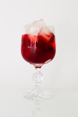 Wine in glass with ice Stock Photo