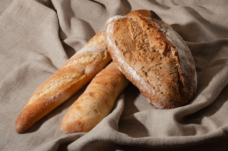 French bread with linen fabric with folds Stock Photo