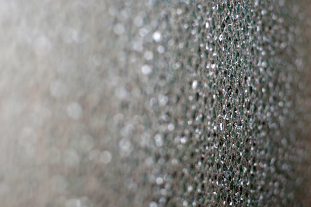 Abstract bokeh background. drops on the gray glass. Background with space for text