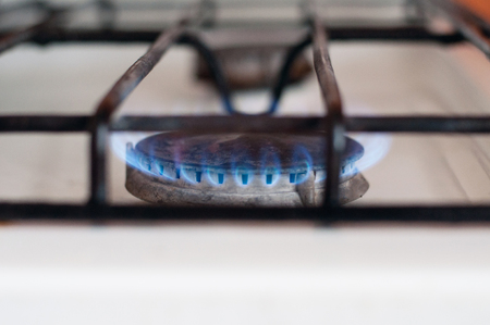 gas burner flame on a gas stove Stock Photo