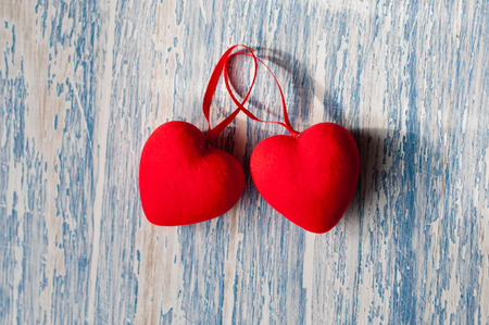 Two red hearts on a blue wooden background. Holiday Valentines Day, wedding