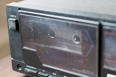 Background, old tape recorder with a cassette