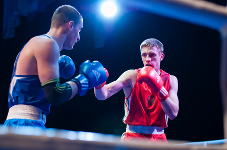 Ukraine, the city of Chernigov, April 9, 2018. Boxing tournament among professional boxers from Ukraine, Moldova, Turkey, Kazakhstan. Two professional boxers in the ring during the fight