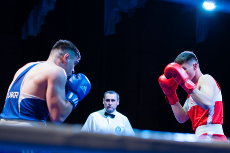Ukraine, the city of Chernigov, April 9, 2018. Boxing tournament among professional boxers from Ukraine, Moldova, Turkey, Kazakhstan. Two professional boxers in the ring Editorial