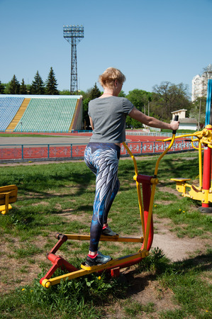sports fitness woman exercising outdoors on a sports field Foto de archivo