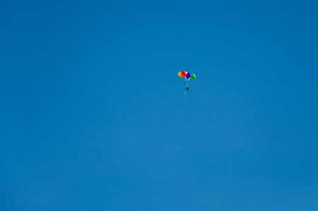 Background of multi-colored balls flying in the blue sky