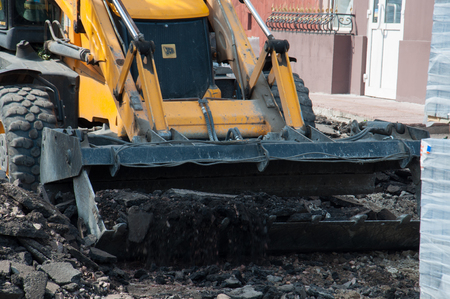 Ukraine, Chernigov, September 20, 2018: road works, asphalt replacement in the city. Work on the tractor removes old asphalt.