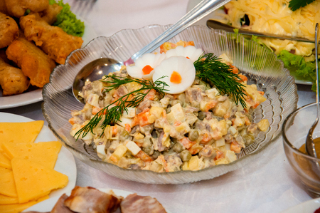 Olivier salad with eggs, meat, mayonnaise sauce. Festive food, New Year's holiday.