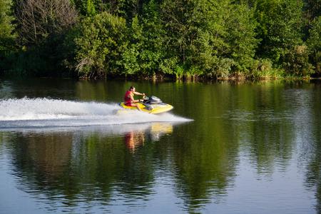 Ukraine, Sednev, the river Snov August 15, 2015: sports man riding a water bike, jet ski. Extreme sports, tourism, healthy lifestyle
