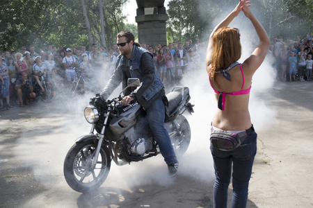 Ukraine, Chernigov, June 30, 2013: Extreme City Extreme Sports Festival. Biker shows, bikers perform tricks on motorcycles