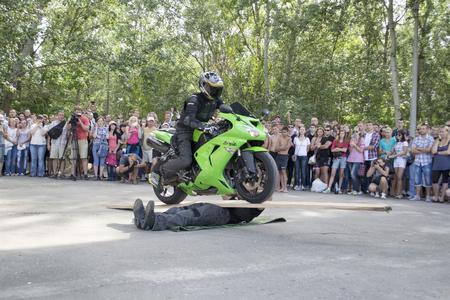 Ukraine, Chernigov, June 30, 2013: Extreme City Extreme Sports Festival. Biker shows, bikers perform tricks on motorcycles