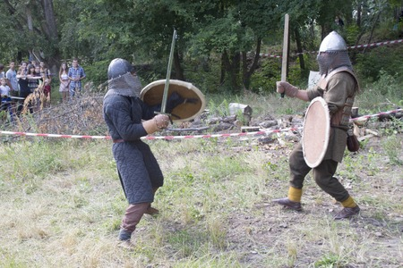 Ukraine, Chernigov, June 30, 2013: Extreme City Extreme Sports Festival. Historical reconstruction battles of knights with swords. The concept of tourism, leisure, hobby