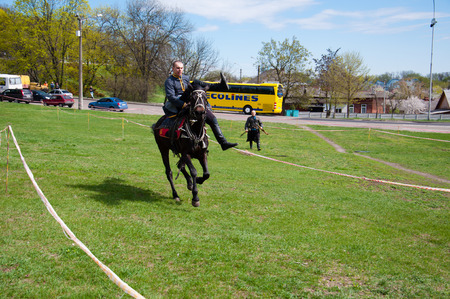 Ukraine, Chernihiv, April 16, 2016: a city holiday, the opening of the tourist season in Chernihiv. Horseman, Cossack. Indicative circus performance on horseback. International Tourism Day Editöryel