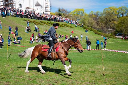 Ukraine, Chernihiv, April 16, 2016: a city holiday, the opening of the tourist season in Chernihiv. Horseman, Cossack. Indicative circus performance on horseback. International Tourism Day Editöryel