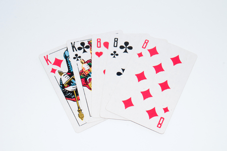 Playing cards on a white background, winning combination, copy space for text.
