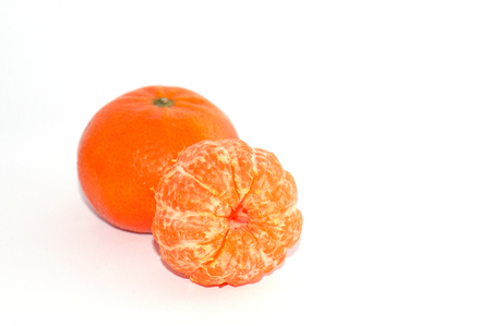 Two juicy tangerine on a white background, macro