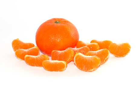Whole tangerine and slices on a white background Stock fotó