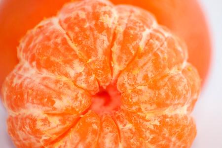 Tangerine macro, juicy ripe sweet tangerine slices close-up