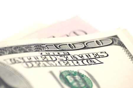 One hundred dollars close up money on white background with copy space from top