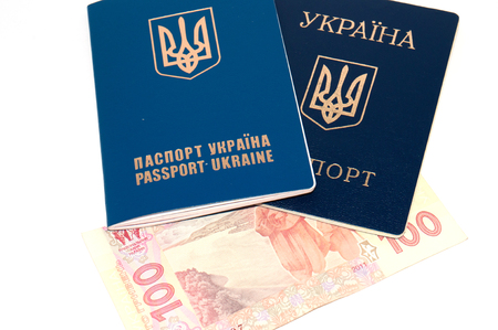 Ukrainian passport and money on a white background, copy space