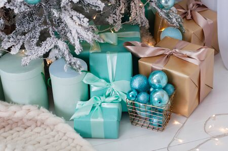 Christmas, Christmas background a lot of gifts under the tree turquoise tones Standard-Bild - 131209587