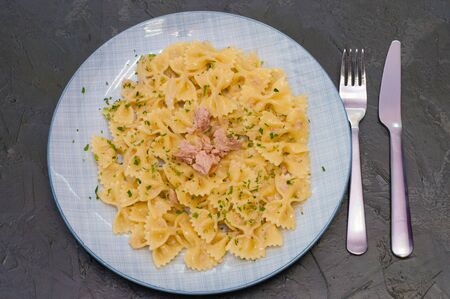 Delicious traditional Italian food. Pasta with tuna, cheese and spices Standard-Bild - 131676990