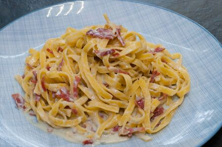 Very tasty pasta with cheese and sausage. Traditional Italian dish Фото со стока