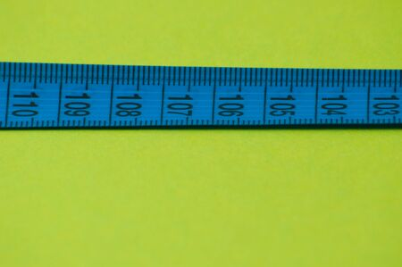 Centimeter on green background. Concept diet, healthy nutrition and weight loss