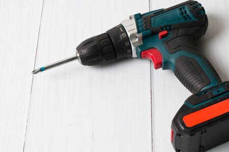 Screwdriver on a wooden background with the Mets to insert text. The concept of construction repair, improvement of housing conditions Stock Photo